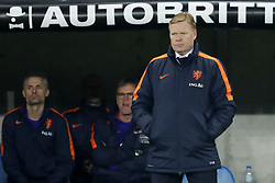 (L-R) assistant trainer Kees van Wonderen of Holland, assistant trainer Dwight Lodeweges of Holland, coach Ronald Koeman of Holland during the International friendly match match between Portugal and The Netherlands at Stade de Genève on March 26, 2018 in Geneva, Switzerland