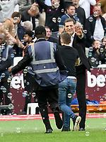 Football - 2017 / 2018 Premier League - West Ham United vs. Swansea City<br /> <br /> A fan , invades the pitch & runs towards West Ham manager Slaven Bilic  after West Ham score, at The London Stadium.<br /> <br /> COLORSPORT/WINSTON BYNORTH