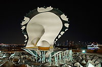 Doha ,Qatar -December 26 , 2019 : The Pearl Monument foutain on Doha corniche promenade waterfront