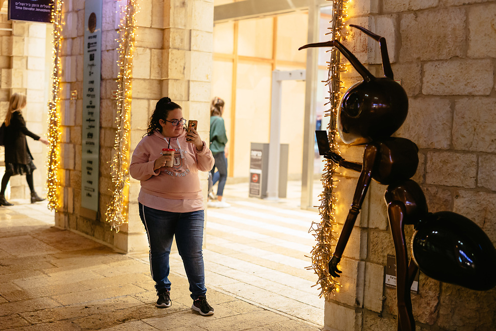 Ruth Borovsky, 29, a former ultra-Orthodox Jewish woman that has left the strict Jewish religious community in which she lived for most of her life, is seen taking a photograph of a sculpture using her smartphone at Mamilla Mall, also called Alrov Mamilla Avenue, an upscale shopping street and the only open-air mall in Jerusalem, Israel, on November 25, 2019. Ruth Borovsky is a client of Hillel - The Right to Choose, an Israeli non-profit organization dedicated to helping young adults who have left the ultra-Orthodox Jewish world integrate and lead successful lives as members of secular Israeli society.