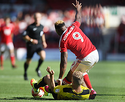 Kyle McFadzean of Burton Albion (L) fouls Britt Assombalonga of Nottingham Forest - Mandatory by-line: Jack Phillips/JMP - 06/08/2016 - FOOTBALL - The City Ground - Nottingham, England - Nottingham Forest v Burton Albion - EFL Sky Bet Championship