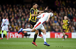 Watford's Troy Deeney (left) and Crystal Palace's James Tomkins battle for the ball