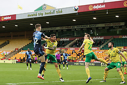 Josh Knight of Wycombe Wanderers heads the ball under pressure from Xavi Quintilla of Norwich City - Mandatory by-line: Arron Gent/JMP - 24/10/2020 - FOOTBALL - Carrow Road - Norwich, England - Norwich City v Wycombe Wanderers - Sky Bet Championship