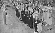 Members of the Women's Volunteer Defence Corps being trained in rifle drill:1940. Small arms were in short supply and only the instructor has a weapon, the women are improvising with walking sticks, umbrellas and even broom handles  World War II.