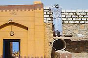A builder working on Gharb Aswan Village