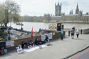 Hunger striking members of a pro-democracy group, protest at the coup led by Myanmar's military rulers, opposite the British Houses of Parliament, on 27th April 2021, in London, England.