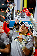 Kansas City Chiefs quarterback Patrick Mahomes (15) holds the Vince Lombardi Trophy after winning Super Bowl 54 against the San Francisco 49ers at Hard Rock Stadium on Sunday, February 2, 2020 in Miami Gardens, Florida.