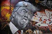 Street art mural of a grimmacing former US President Donald Trump in Digbeth on 31st March 2021 in Birmingham, United Kingdom. Trump and the image of him has been the subject of much derision both during and after his presidency, and to some becoming a figure of hate, who has been heavily satirised and mocked.