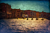 """""""Silhouette of Gondoliers against the late sun on the Grand Canal near the Church of Santa Maria del Giglio""""…<br /> <br /> """"Venice"""" - Henry Wadsworth Longfellow: <br /> WHITE swan of cities, slumbering in thy nest<br /> So wonderfully built among the reeds<br /> Of the lagoon, that fences thee and feeds,<br /> As sayeth thy old historian and thy guest!<br /> White water-lily, cradled and caressed<br /> By ocean streams, and from the silt and weeds<br /> Lifting thy golden pistils with their seeds,<br /> Thy sun-illumined spires, thy crown and crest!<br /> White phantom city, whose untrodden streets<br /> Are rivers, and whose pavements are the shifting<br /> Shadows of palaces and strips of sky;<br /> I wait to see thee vanish like the fleets<br /> Seen in mirage, or towers of cloud uplifting<br /> In air their unsubstantial masonry.<br /> <br /> The gondola is a traditional, flat-bottomed Venetian rowing boat, well suited to the conditions of the Venetian lagoon. The rowing oar, which is not fastened to the hull, is used in a sculling manner, also acting as the rudder. For centuries the gondola was the chief means of transportation and most common watercraft within Venice. It is propelled by a gondolier. In modern times the iconic boats still have a role in public transportation in the city, serving as traghetti (ferries) over the Grand Canal. There are just over four hundred gondolas in active service today, virtually all of them used for hire by tourists. In order to become a professional gondolier, you need to obtain a license from the guild. Two hundred years ago, there were 10,000 gondolas in Venice. Although the aristocracy preferred horses to boats through the early Middle-Ages, beginning in the 14th century when horses were outlawed from the streets of Venice, the noble class embraced gondolas as a respectable form of transportation."""