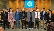 Don Hernandez poses with members of the Bellaire High School debate team during the Board of Trustees meeting, June 11, 2015.