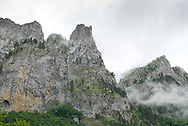 Đevojka and other crags wreathed in low cloud line the Ropojana valley, on the border with Albania, on the hike from Vusanje in Montenegro to Theth in Albania, part of the Peaks of the Balkans Trail. Prokletije National Park, Montenegro © Rudolf Abraham