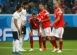June 19, 2018 - Saint Petersburg, Russia - Artem Dzyuba (C)  of the Russia national football team vie for the ball during the 2018 FIFA World Cup match, first stage - Group A between Russia and Egypt at Saint Petersburg Stadium on June 19, 2018 in St. Petersburg, Russia. (Credit Image: © Igor Russak/NurPhoto via ZUMA Press)