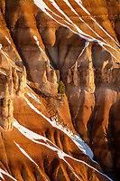 Layers of eroded sandstone and a mix of snow makes Bryce Canyon National Park one of the most scenic places to visit in the State of Utah.