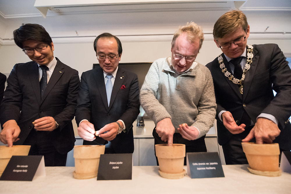 """9 December 2017, Oslo, Norway: Some 22 """"Hibakusha"""", survivors from the atomic bombings in Hiroshima and Nagasaki, joined Norwegian representatives the mayor of Oslo, principal of Oslo University, and the head of the Oslo Museum of National History for an event themed """"Seeds for Peace"""" in the Oslo Botanical Garden. As a token of hope, together they planted seeds, as part of the Nobel Peace Prize celebrations in Oslo on 9-10 December. Oslo hosts the Nobel Peace Prize award ceremony on 9-10 December 2017. The prize in 2017 goes to the International Campaign to Abolish Nuclear Weapons (ICAN), for """"its work to draw attention to the catastrophic humanitarian consequences of any use of nuclear weapons and for its ground-breaking efforts to achieve a treaty-based prohibition of such weapons"""". """"Peace is more than absence of war,"""" said Oslo governing mayor Raymond Johansen. """"We need to look at peace also in a positive way, and governments cannot do this alone. For this, we need also civil society."""""""