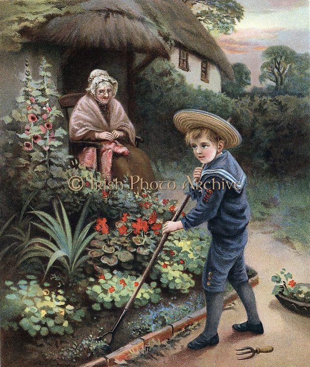 A Labour of Love. Little boy in straw hat and sailor suit, hoes the flower garden for his grandmother who sits watching outside her thatched country cottage. Chromolithograph from 'The Prize for Girls and Boys', London, 1905.