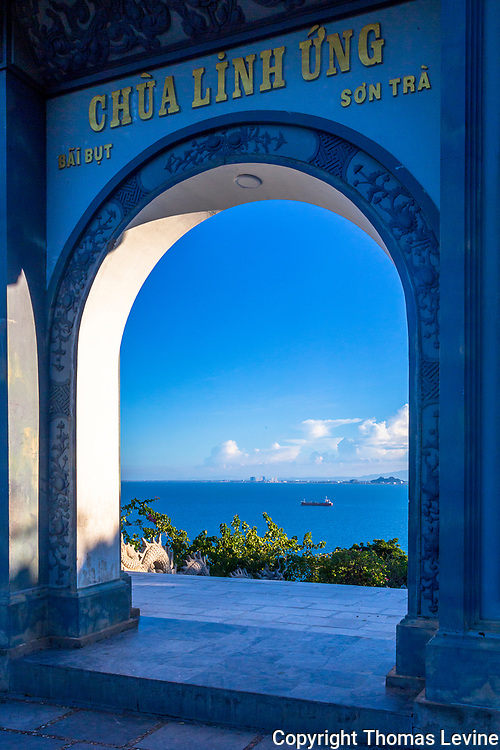 Looking Through an arch from Quận Sơn Trà Buddhist Temple in Da Nang. It's high off the water but have a beautiful view.