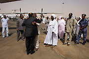 British Labour peer, Lord Ahmed of Rotherham hugs the govenor of north Darfur, Osman Mohammed Yousef Kibir at Al Fashir airport, Sudan in front of digitaries and officials. Nazir, Baron Ahmed (born 1958) is a member of the House of Lords, having become the United Kingdom's first Muslim life peer in 1998 and is in this war-torn province of Sudan to attend the first-ever international Conference on Womens' Challenge in Darfur, hosted by the govenor in his own compound.