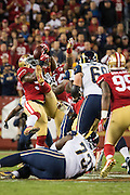 San Francisco 49ers inside linebacker NaVorro Bowman (53) makes an interception with the help of nose tackle Mike Purcell (64) against the Los Angeles Rams at Levi's Stadium in Santa Clara, Calif., on September 12, 2016. (Stan Olszewski/Special to S.F. Examiner)