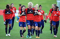 England Women's Millie Bright (centre), Karen Carney (left) and Laura Bassett during the training session at St George's Park, Burton.