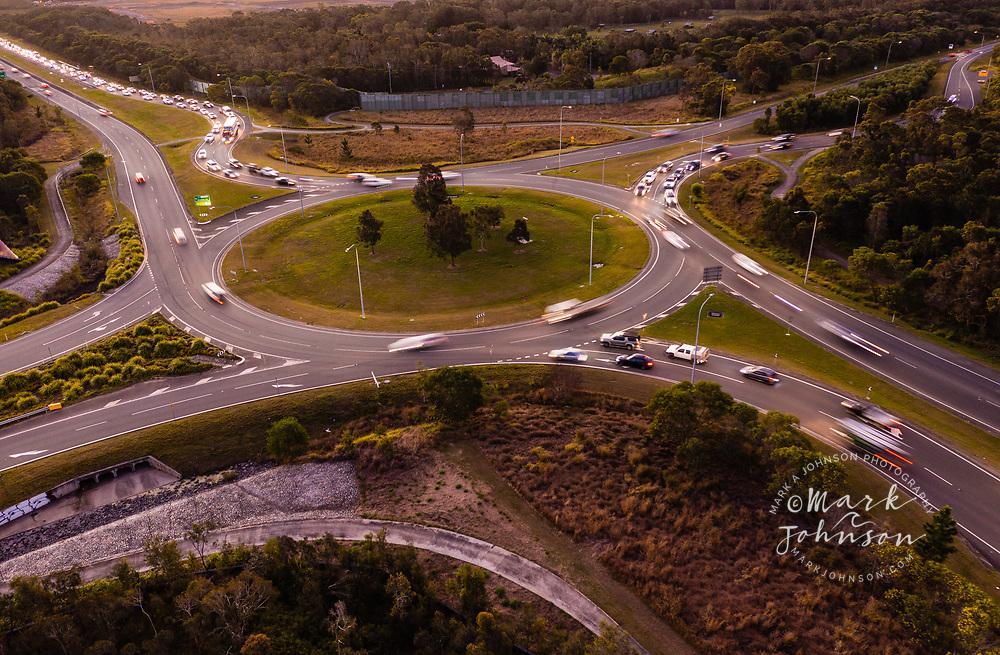 Aerial view of traffic on the Caloundra Road/Kawana Link Road/Bells Creek Arterial Road roundabout, Caloundra, Queensland, Australia