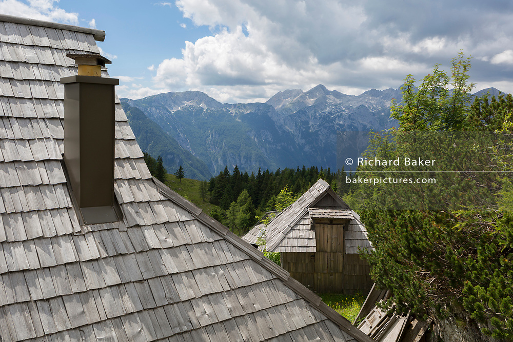 A Slovenian herder's mountain holiday hut in Velika Planina, on 26th June 2018, in Velika Planina, near Kamnik, Slovenia. Velika Planina is a mountain plateau in the Kamnik–Savinja Alps - a 5.8 square kilometres area 1,500 metres (4,900 feet) above sea level. Otherwise known as The Big Pasture Plateau, Velika Planina is a winter skiing destination and hiking route in summer. The herders' huts became popular in the early 1930s as holiday cabins (known as bajtarstvo) but these were were destroyed by the Germans during WW2 and rebuilt right afterwards by Vlasto Kopac in the summer of 1945.