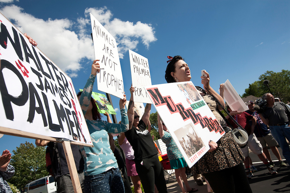 Rachel Augusta of the Animal Rights Coalition and Minnesota Animal Liberation Front speaks out against trophy hunting at a protest at the dental office of lion hunter Walter James Palmer in Bloomington, MN, July 29, 2015.