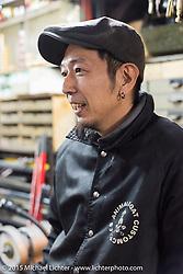 Daisuke Mukasa during a shop visit to his Animal Boat custom motorcycle shop after Mooneyes. Tokyo, Japan. December 8, 2015.  Photography ©2015 Michael Lichter.