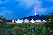 A summer storm passes over Yellowstone Under Canvas near West Yellowstone, Montana