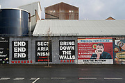 Belfast Peace Wall. Falls Road side. with progressive and revolutionary murals. The peace lines or peace walls are a series of separation barriers in Northern Ireland that separate predominantly Republican and Nationalist Catholic neighbourhoods from predominantly Loyalist and Unionist Protestant neighbourhoods. They have been built at urban interface areas in Belfast, Derry, Portadown and elsewhere. The stated purpose of the peace lines is to minimise inter-communal violence between Catholics of whom are nationalists who self-identify as Irish) and Protestants of whom are unionists who self-identify as British).