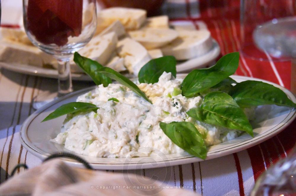 Salad with sour cream sourcream mixed with fresh garlic. Tradita traditional restaurant, Shkodra. Albania, Balkan, Europe.