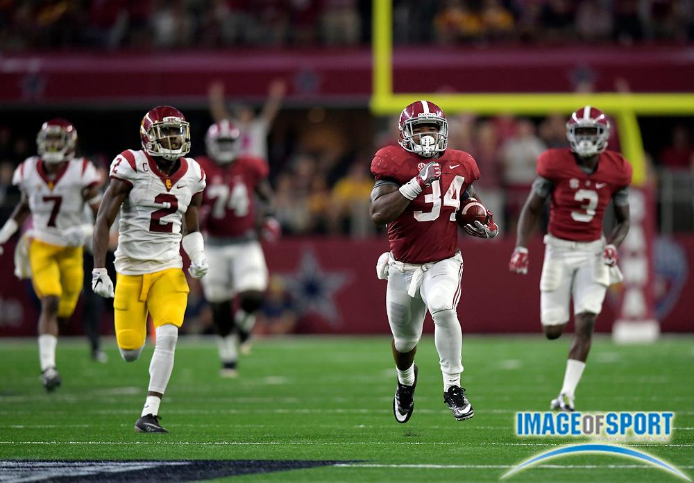 Sep 3, 2016; Arlington, TX, USA; Alabama Crimson Tide running back Damien Harris (34) runs past USC Trojans defensive back Adoree' Jackson (2) during the third quarter at AT&T Stadium.