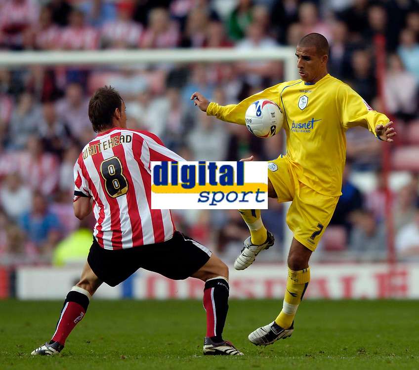 Photo: Jed Wee.<br />Sunderland v Sheffield Wednesday. Coca Cola Championship. 30/09/2006.<br /><br />Sheffield Wednesday's Marcus Tugay (R) controls the ball as Sunderland's Dean Whitehead looks on.
