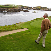 Former club pro Jim Langley at Cypress Point in Pebble Beach, on the private course's signature par number 16.
