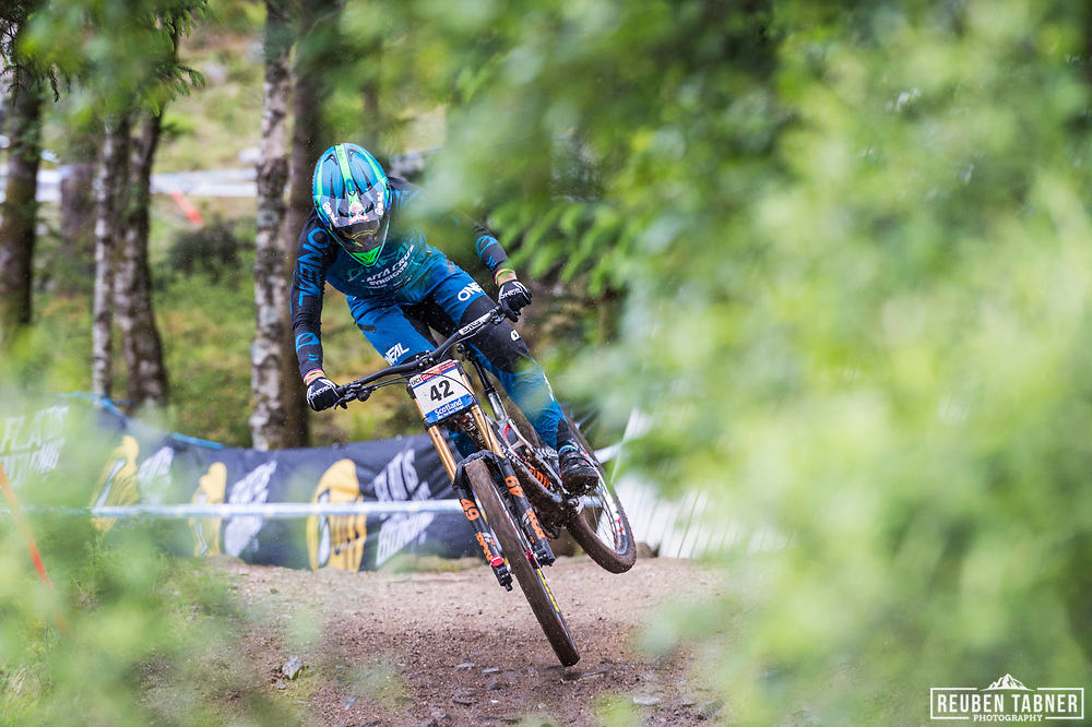 South African Greg Minnaar of Santa Cruz Syndicate cruses to take his 7th win at the Fort William UCI Mountain Bike World Cup, despite the rain which started just before his run.