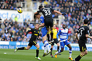 Reading's Pavel Pogrebnyak is challenged by Wigan's Paul Scharner (33). Barclays Premier league, Reading v Wigan Athletic at the Madejski Stadium in Reading on Saturday 23rd Feb 2013. pic by Andrew Orchard, Andrew Orchard sports photography,