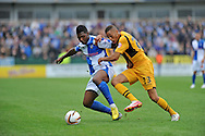 Christian Jolley of Newport County (r) challenges Ellis Harrison of Bristol Rovers. Skybet League two match, Newport county v Bristol Rovers at Rodney Parade in Newport, South Wales on Saturday 17th August 2013. pic by Phil Rees ,Andrew Orchard sports photography,