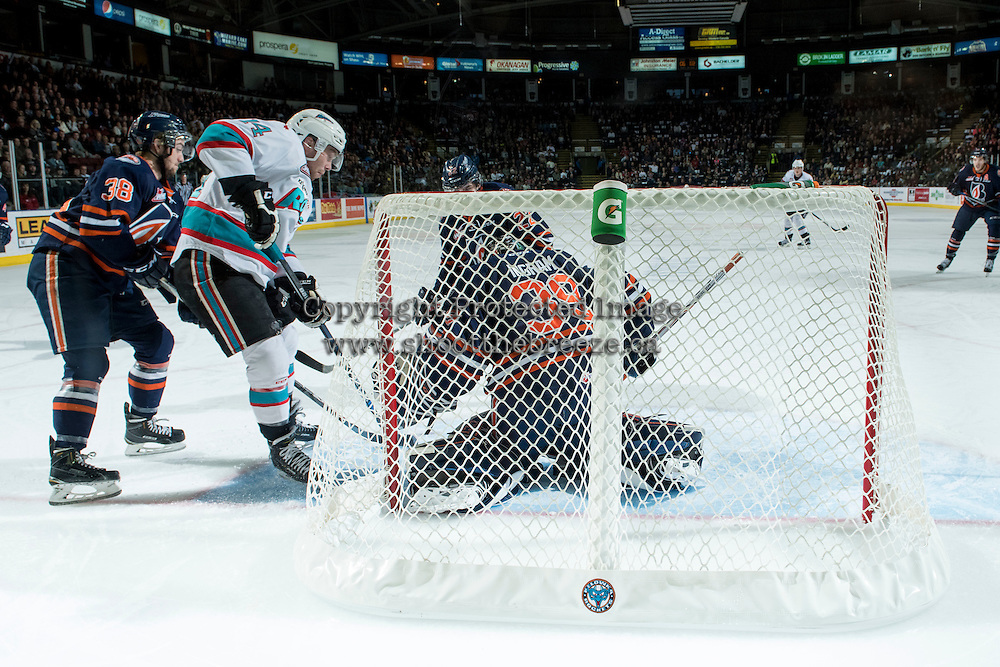 KELOWNA, CANADA - MARCH 26: Rourke Chartier #14 of Kelowna Rockets attempts a goal on Connor Ingram #39 of Kamloops Blazers on March 26, 2016 at Prospera Place in Kelowna, British Columbia, Canada.  (Photo by Marissa Baecker/Shoot the Breeze)  *** Local Caption *** Connor Ingram; Rourke Chartier;