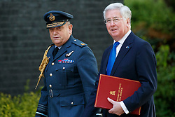 © Licensed to London News Pictures. 10/05/2017. London, UK. Chief of the Defence Staff SIR STUART PEACH and Defence Secretary MICHAEL FALLON arrive at Downing Street, London for a meeting with Nato Secretary General Jens Stoltenberg on Wednesday, 10 May 2017. Photo credit: Tolga Akmen/LNP