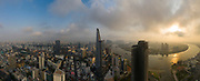 Ho Chi Minh City, District One, Vietnam. Classic drone panorama of all key buildings and the Saigon River in golden morning sunlight.