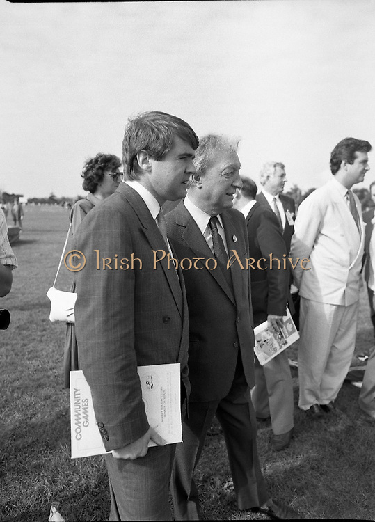 Charles Haughey Visits The Community Games. (T5)..1989..03.10.1989..10.03.1989..3rd September 1989..An Taoiseach, Charles Haughey TD,accompanied by Mr Frank Fahey, TD, Minister of State with responsibility for Youth and Sport attended the Twentieth National Finals of the Community Games at Mosney,  Co.Meath yesterday...Image shows Frank Fahey TD and An Taoiseach taking a keen interest in the javelin event.