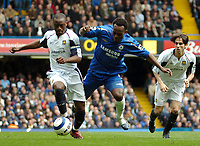 Photo: Ed Godden.<br />Chelsea v West Ham United. The Barclays Premiership. 09/04/2006. Nigel Reo-Coker (L) is challenged by Chelsea's Michael Essien.