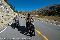 Paul D'Orleans (L) riding Ken McManus' 1936 Harley-Davidson Knucklehead alongside Alan Stulberg of Revival Cycles (Austin) on Bryan Bossier's 1933 Brough Superior 11-50 after crossing the Continental Divide at Loveland Pass during Stage 10 (278 miles) of the Motorcycle Cannonball Cross-Country Endurance Run, which on this day ran from Golden to Grand Junction, CO., USA. Monday, September 15, 2014.  Photography ©2014 Michael Lichter.
