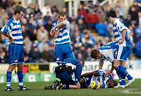 Photo: Gareth Davies.<br />Reading v Sheffield United. The Barclays Premiership. 20/01/2007.<br />Reading's Ibrahima Sonko (Bottom) lies injured on the floor and is later replaced.