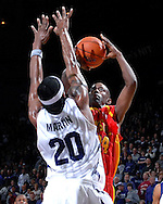 Iowa State guard Mike Taylor (24) puts up a first half shot over Kansas State forward Cartier Martin (20) at Bramlage Coliseum in Manhattan, Kansas, February 17, 2007.  K-State defeated Iowa State 65-47.