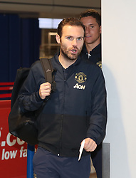 Juan Mata of Manchester United is spotted on his way to catch a flight as the team fly to Turin on Tuesday afternoon to play Juventus in The Champions League on Wednesday night.