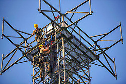 Airman Jacob Pugh and Airman 1st Class Brandon Culp, 14th Operations Support Squadron Radar, Airfield and Weather Systems journeymen, attach new wiring on a radio tower July 16, 2018, on Columbus Air Force Base, Miss. The RAWS unit supports base and regional radar equipment, ground-to-air radios and weather systems that support air traffic control, the National Weather Service, and command and control across the wing. (U.S. Air Force photo by Airman 1st Class Keith Holcomb)
