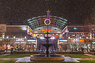 The first snow in Huntington, West Virginia of 2017 hits Pullman Square, the fountain and streets adorned with Christmas decorations.