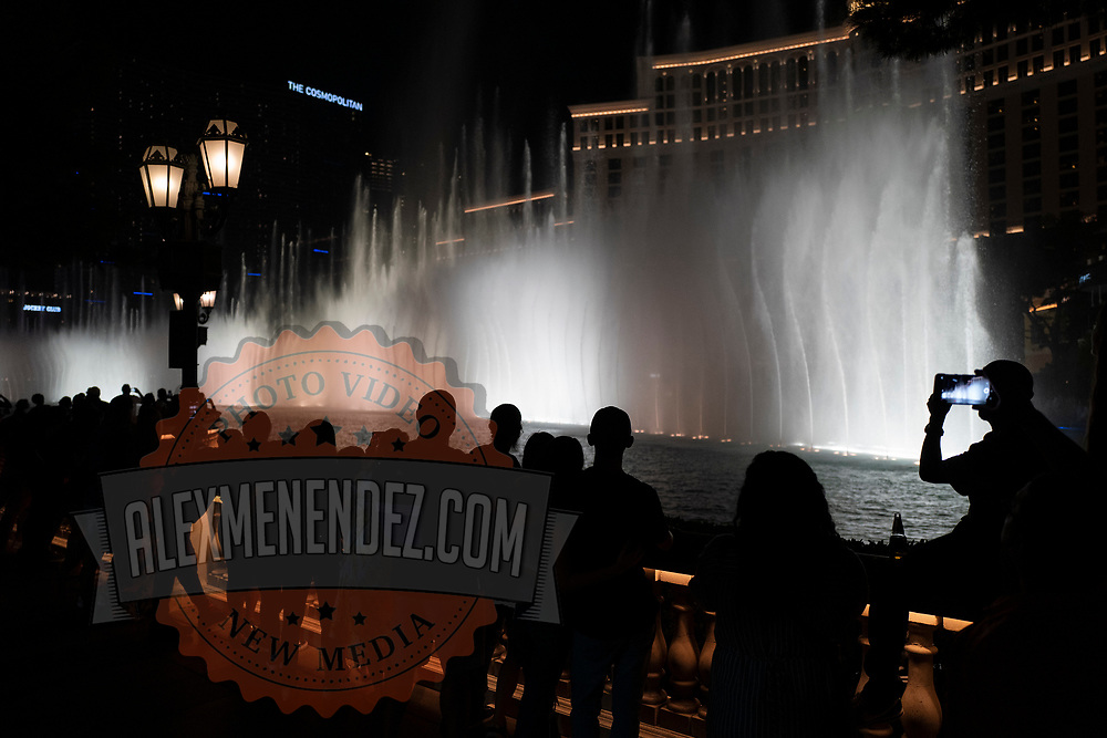 The water show at the Bellagio Hotel on the Las Vegas Strip draws visitors in Las Vegas, Nevada on Monday, October 19, 2020. (Alex Menendez via AP)