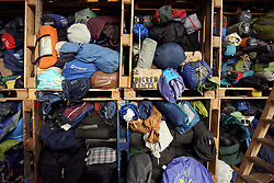 18 November 2020. Care4Calais - Calais, France.<br /> Care4Calais warehouse. Tents, all cleaned, pre sorted and checked to ensure they are in good condition are packed into racks by volunteers ready for later distribution to desperate migrant refugees - many of whom have little in the way of warm clothing as winter approaches. Tents are often slashed, destroyed and confiscated by authorities, even as winter approaches.<br /> Claire Moseley, founder of the British volunteer run refugee charity Care4Calais works tirelessly to build her foundation  to help migrant refugees as they struggle to survive on the streets of Calais where they are constantly harassed and moved on by authorities. Care4Calais provides meals, clothing, haircuts, charging stations for phones, medical aid, hot drinks, tents, blankets and a wide range of goods and services.<br /> Photo©; Charlie Varley/varleypix.com