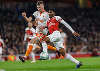 Football - 2018 / 2019 EFL Carabao (League) Cup - Fourth Round: Arsenal vs. Blackpool<br /> <br /> Ainsley Maitland-Niles (Arsenal FC) is shadowed by Paudie O'Connor (Blackpool FC) at The Emirates.<br /> <br /> COLORSPORT/DANIEL BEARHAM